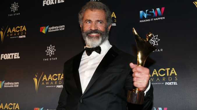 Mel Gibson poses in the media room after winning the AACTA Award for Best Direction for Hacksaw Ridge.