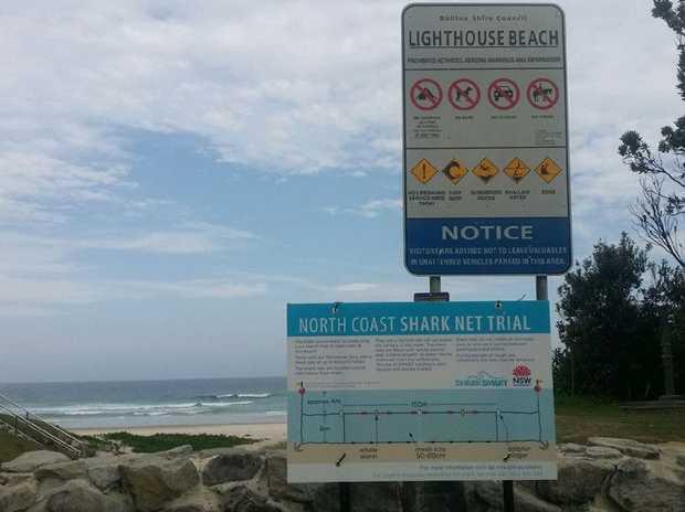 A sign at Lighthouse Beach, Ballina, advising of the shark net trial.