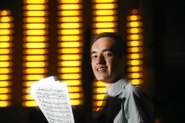 CAROL TIME: Student Alex Pereira prepares for his bass solo which he will sing at 'Shop Baby Carols in the Heart' at Oakes Oval.