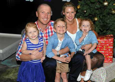 Brad Haddin and his wife Karina pose for a photo with their children Mia, Zac and Hugo at Crown Promendade on Christmas Day in Melbourne in 2014