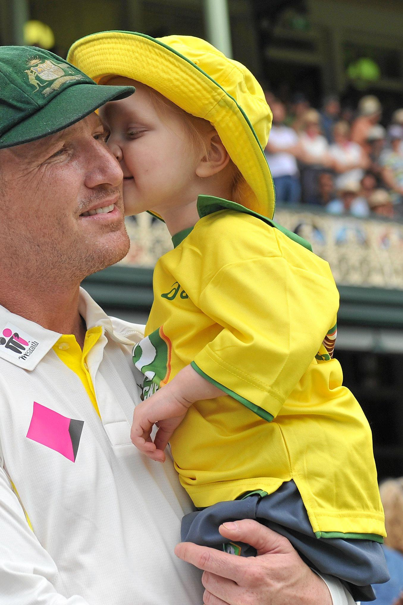Brad Haddin receives a kiss from his daughter Mia.