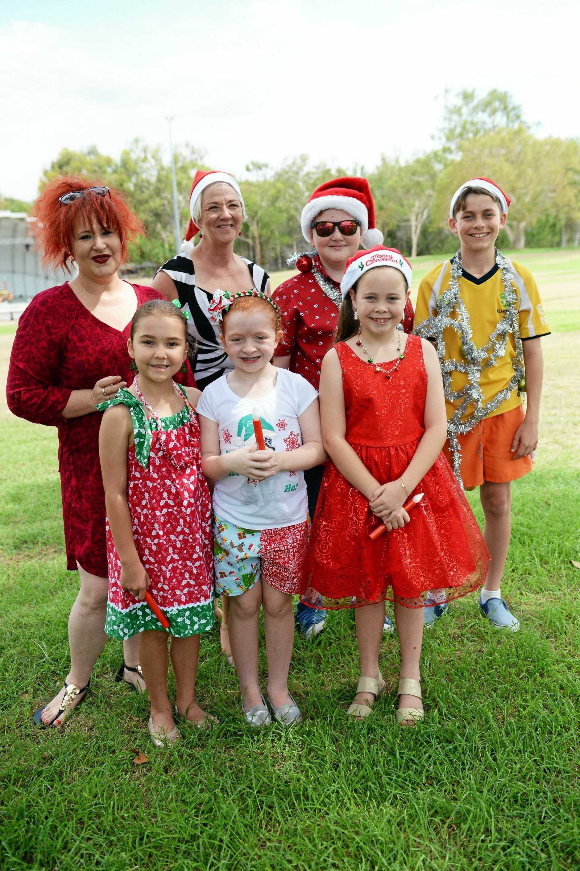 Rockhampton Carols by Candlelight, front: Lily Cooling, Millie O'Brien and Tayah Ellis. Back: Melanie March,  Mayor Margaret Strelow, Elijah March- Hoolihan and Dominic Chavasse.