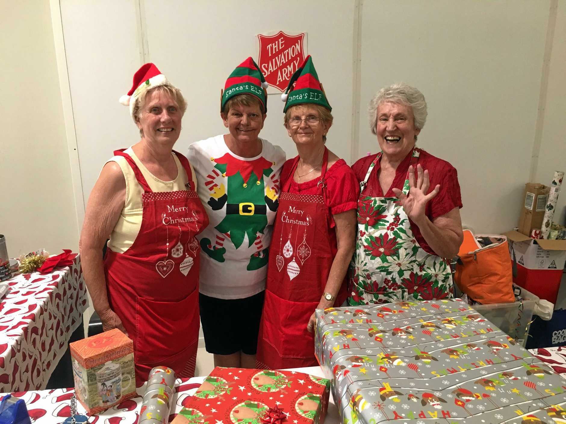 HELPING HAND: Valerie Hendrie, Daphne Rose, Yvonne Hall and June Richardson have been volunteering their time to help wrap Christmas presents for The Salvation Army.