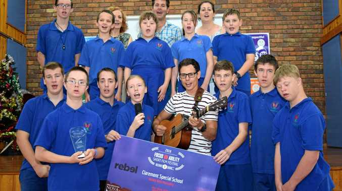 FROM THE HEART: Brett Briggs of CATS with Claremont Special School students, performing the new school song