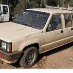 Cream 1987 Mitsubishi TCab Utility rego 898ABJ stolen from Norman Gardens November 3
