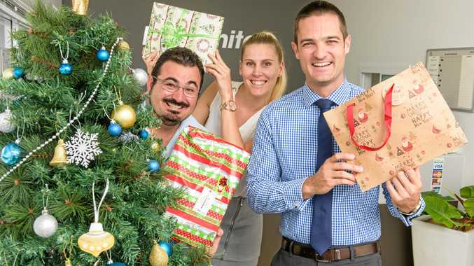 TIME TO GIVE: Lee Johns, Courtney Smith and Daniel Kelly of Ray White Yamba promote their Little Ray Of Giving Christmas gift appeal.