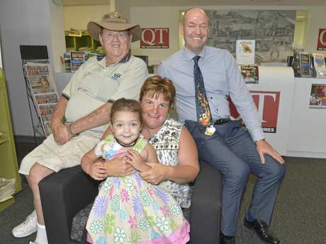 BIG HEARTS: After the QT's article sharing toddler Mayana's story the community quickly offered the cash needed to buy her a special suit. Pictured is Mayana with part-time carer Sharon, Bob Green from Happy Wanderers and Kevin Steed from McNamara & Associates.