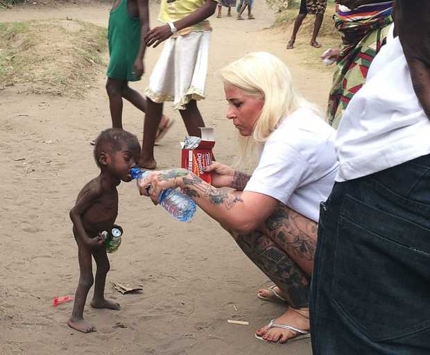 Anja Ringgren Loven gives water to Hope, 2, after finding the emaciated boy wandering the streets in Nigeria Anja Ringgren Lovén/Facebook