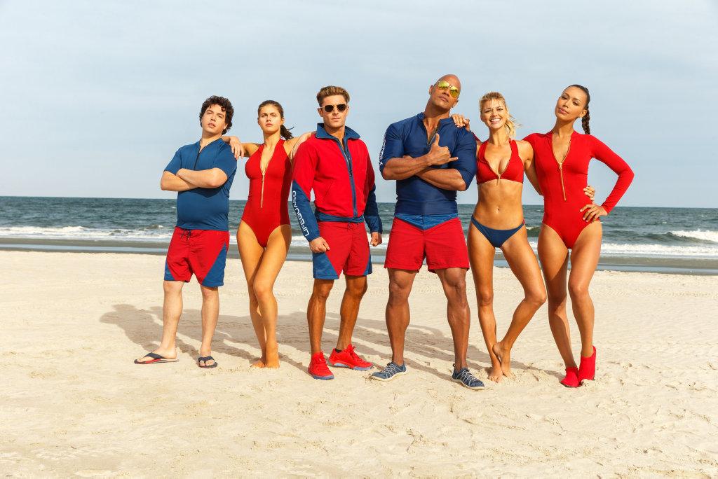 From left, Jon Bass, Alex Daddario, Zac Efron, Dwayne Johnson, Kelly Rohrbach, and Ilfenesh Hadera in a scene from the movie Baywatch.