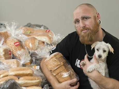 Toowoomba man Jon Hart, holding Newton, has donated food to people in need this Christmas.