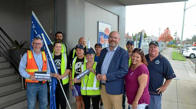 Tim Ayers (centre right) visited Norco in Lismore to announce its huge step towards paid domestic leave.