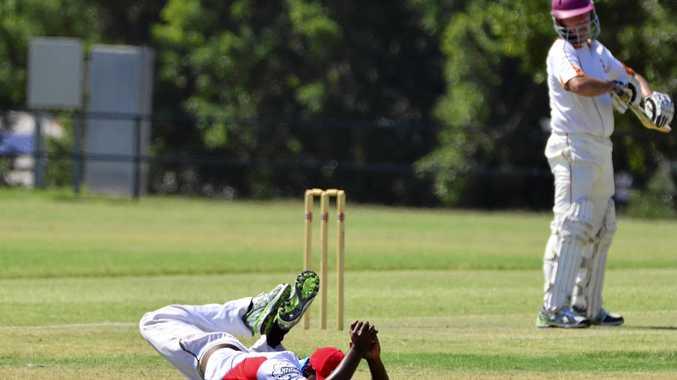 SCREAMER: Swifts fielder Senura Senarathne takes a super catch at second slip to dismiss Taipans batsman Andrew Doyle in their first divisin match at Redbank Plains.