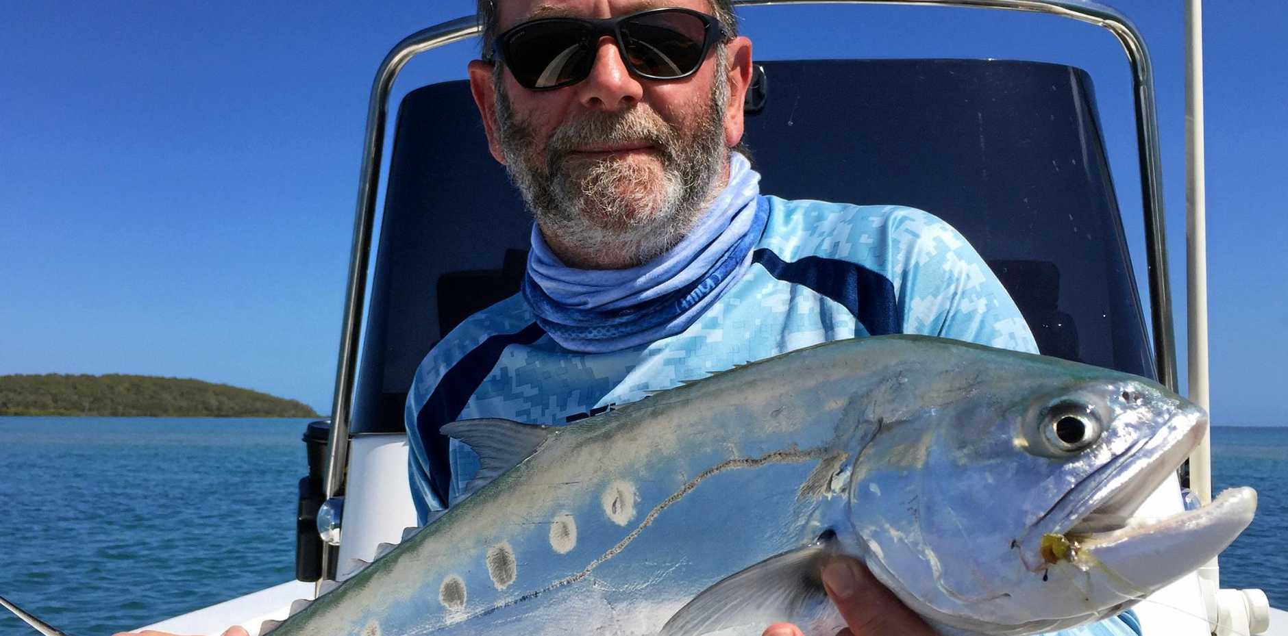 HOOKED: Dave, from New Zealand, with a whopper queenfish.