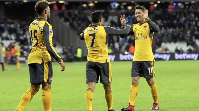 Arsenal's Alexis Sanchez (centre) celebrates with teammates Mesut Ozil (right) and Alex Oxlade-Chamberlain after scoring against West Ham.