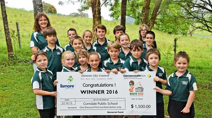 Corndale Public School students receiving their giant cheque and the school's 'Corn Cob of Corndale' recycled sculpture.