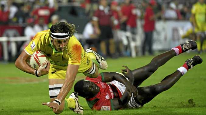 Australia's Sam Myers is tackled by Kenya's defence in round one of the World Rugby Sevens Series in Dubai.