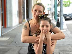 VIDEO: Mum's panic to save daughter trapped under car