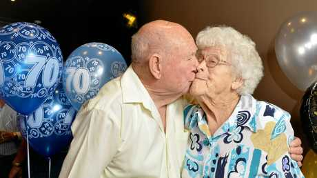 ROMANTIC: Maurice Young plants a celebratory kiss on his wife Elizabeth as they marked their 70th wedding anniversary at Jets Leagues Club.