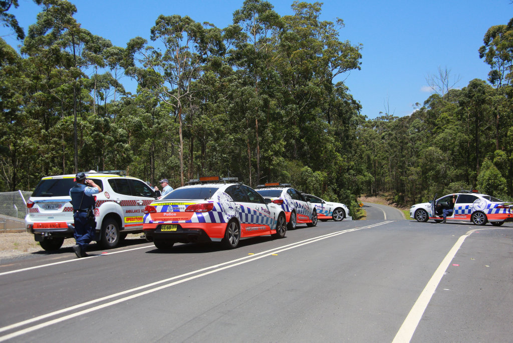 A roadblock has been set up by police near Valla as a search for a gun wielding driver continues. Photo: Frank Redward