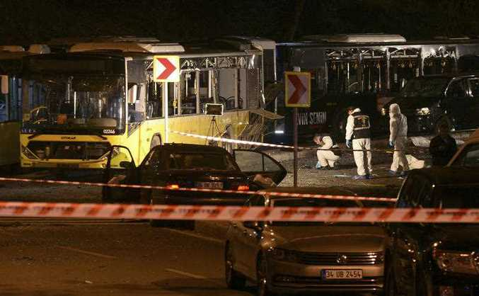 Forensic officials work at the scene of explosions near the Besiktas football club stadium after attacks in Istanbul, late Saturday, Dec. 10, 2016. Two explosions struck Saturday night outside a major soccer stadium in Istanbul after fans had gone home, an attack that wounded about 20 police officers, Turkish authorities said.