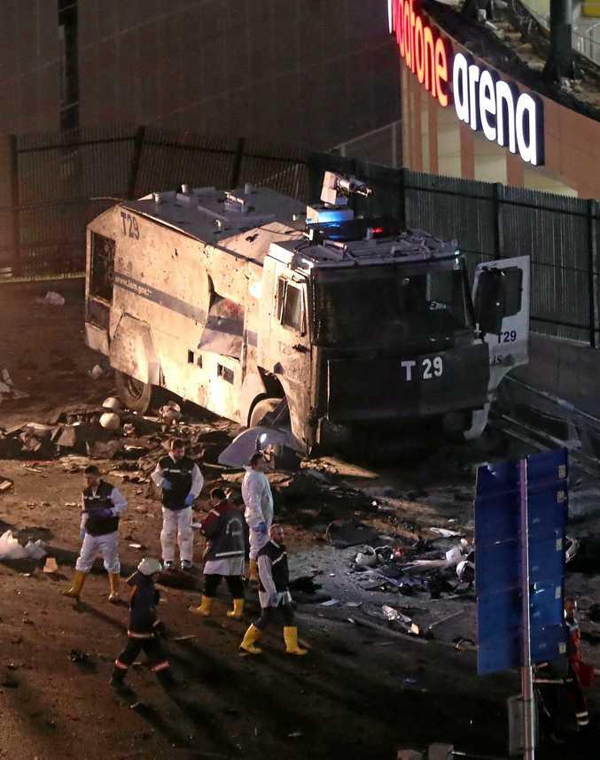 Crime scene investigators outside Vodafone Arena in Istanbul.