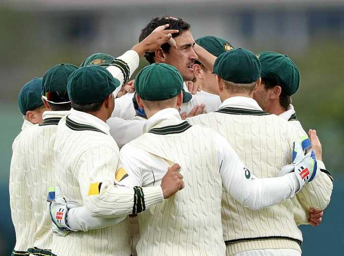 Mitchell Starc of Australia celebrates after taking the wicket of Jean-Paul Duminy of South Africa during day one of the second Test match at Blundstone Arena.