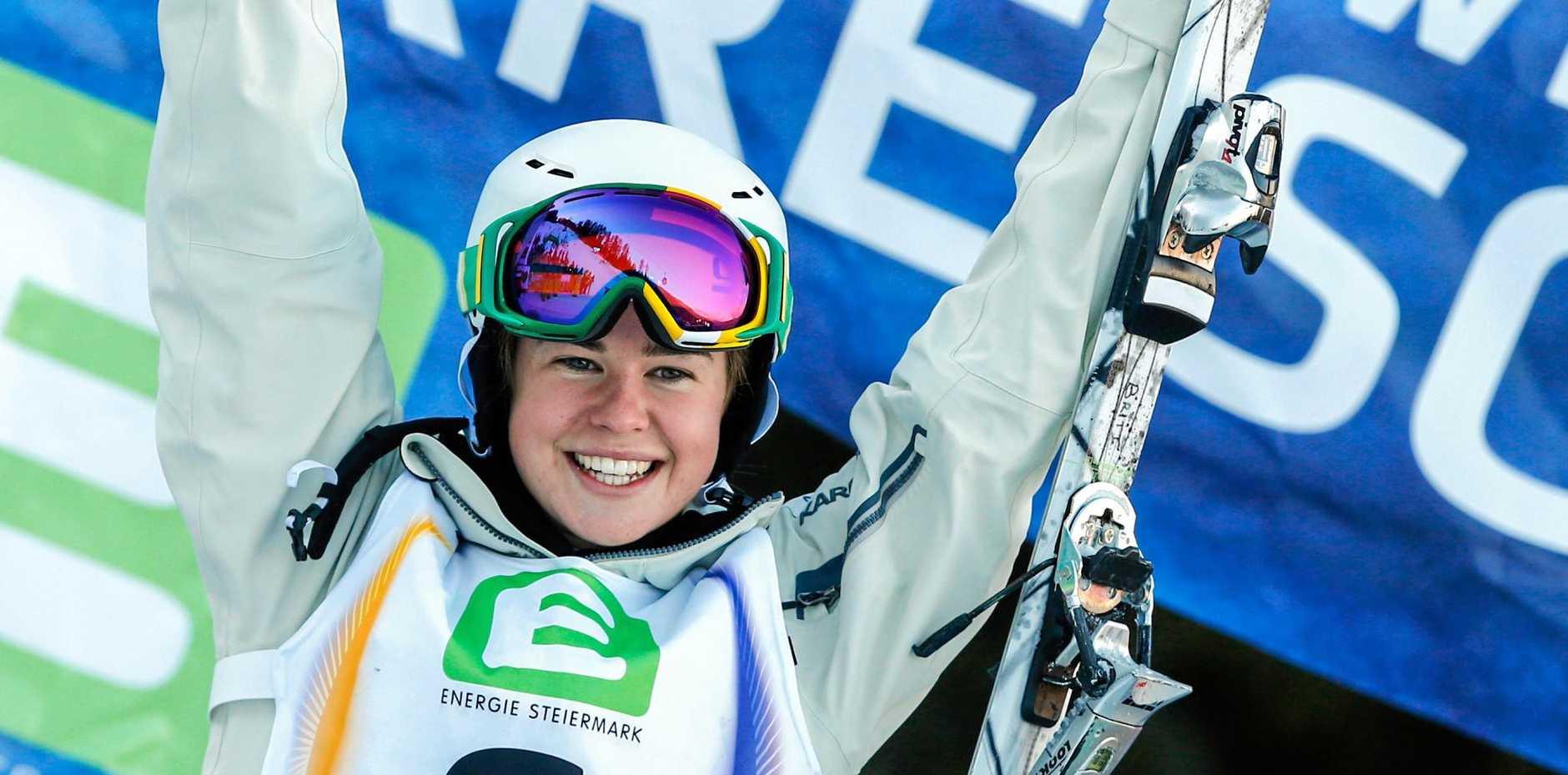 Britt Cox of Australia won a World Cup moguls event in Finland.