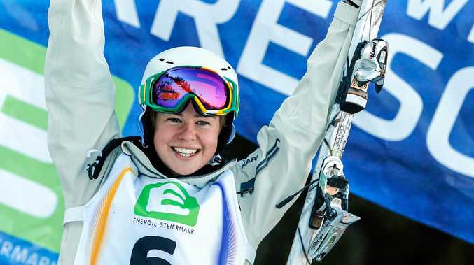 Britt Cox of Australia won a World Cup moguls event in Finland.