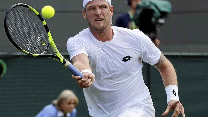 Sam Groth of Australia plays a forehand.