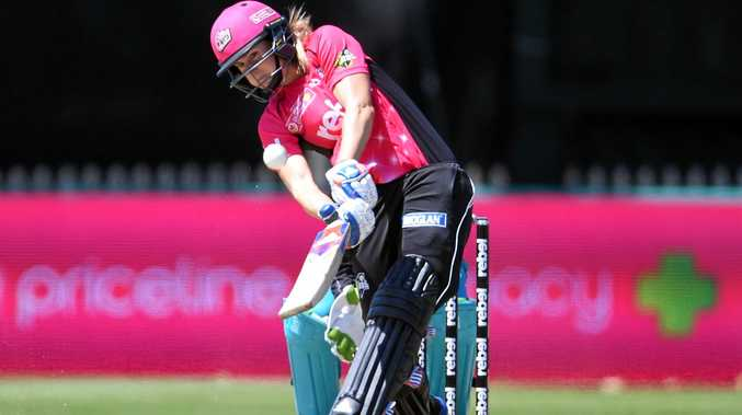 Ellyse Perry hits a shot for the Sydney Sixers.