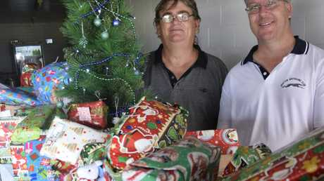 Grafton Greyhound Racing Club committee members Terry Hickson and Brad Ellis with the huge pile of presents donated to the Send A Wish At Christmas Appeal, to be distributed at the Grafton Greyhound Racing Club's race meeting this Monday, 12th December, 2016.Photo Bill North / Daily Examiner