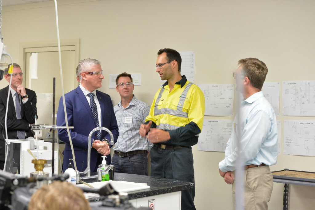 Michael McCormack mp and lead research chemist David Schaller at Northern Oil Refineries.
