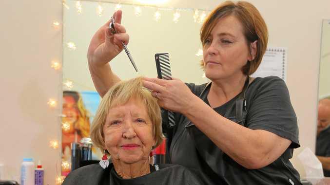 SNIP SNIP: Hair dresser Suzie Bendig spends time cutting Carole Donohue's hair at Coolangatta Senior Citizens Centre.