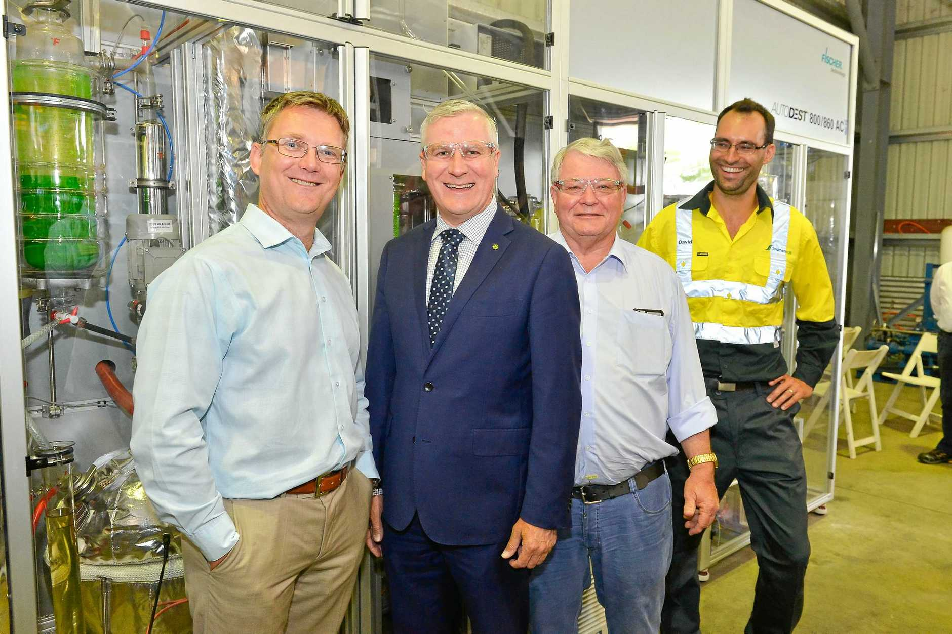 Tim Rose, managing director Northern Oil Refineries, Michael McCormack mp, Ken O'Dowd mp and lead research chemist David Schaller at Northern Oil Refineries.