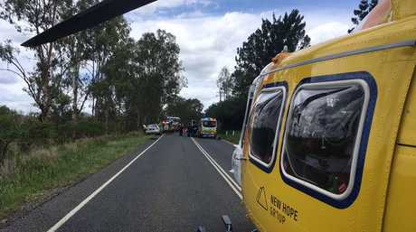 RACQ LifeFlight Rescue crews at the scene of a motorcycle crash on Sunday.