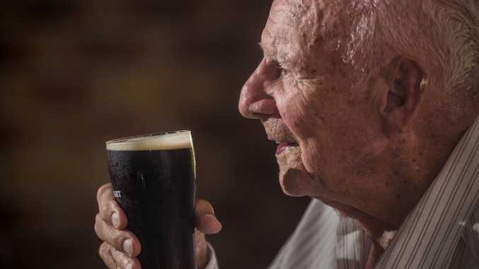 Doug Lewis enjoys a beer with his family and friends celebrating his 100th birthday at his regular haunt the Lawrence Tavern.