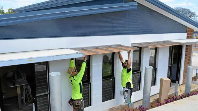 FINISHING TOUCH: Carpenters Izac Browning and Gavin Mead work hard for Gatton's Rooms Hotel to open next week.
