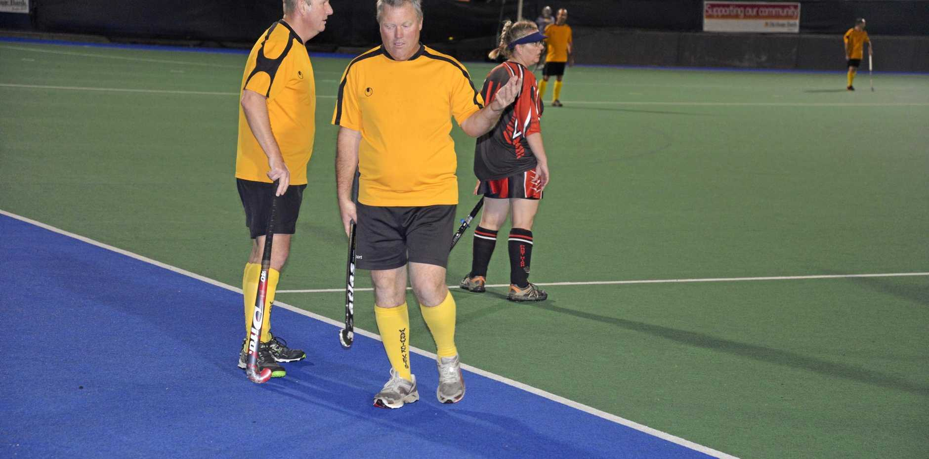 Phil Rolfe (right) and Gary Millard discuss tactics.