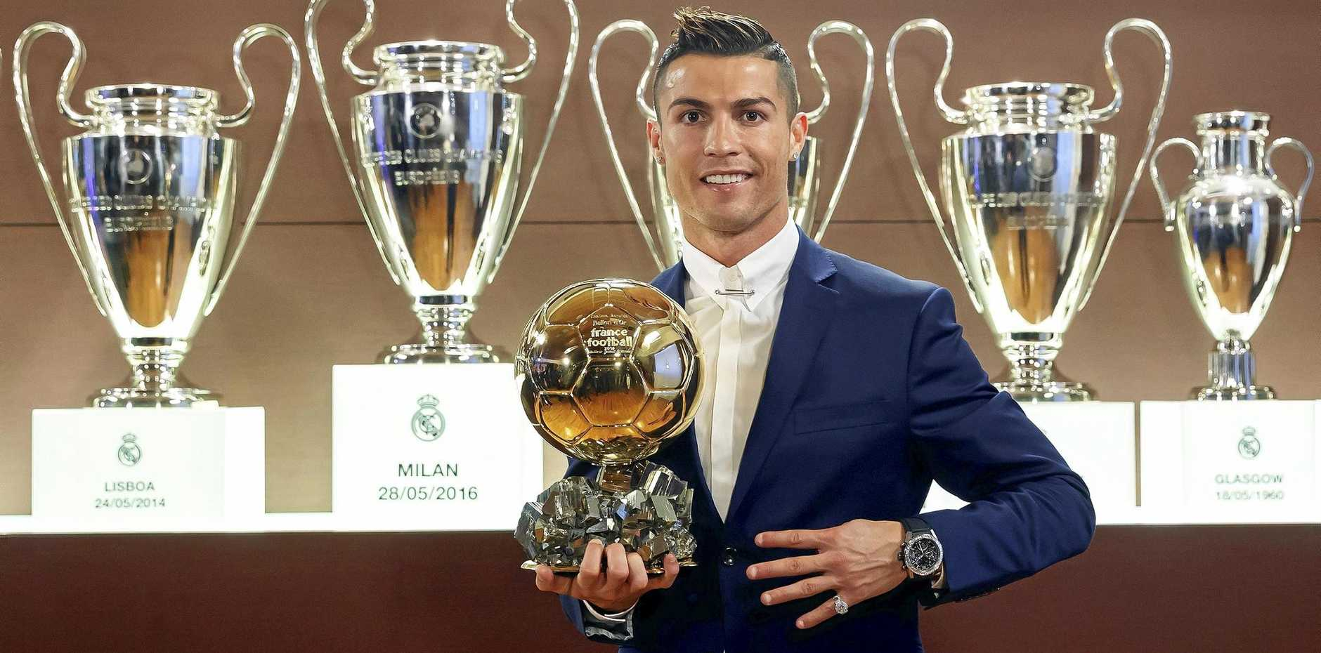 Real Madrid's Portuguese striker Cristiano Ronaldo with the Ballon d'Or.