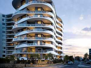 Breeze high-rise opens as controversy settles