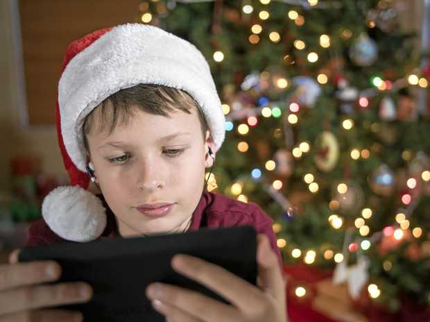 SET GUIDELINES: It's a good idea to set up some house rules for digital devices before putting one under the tree.