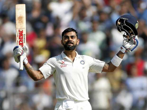 Indian cricket captain Virat Kohli raises his bat after scoring a double century against England.