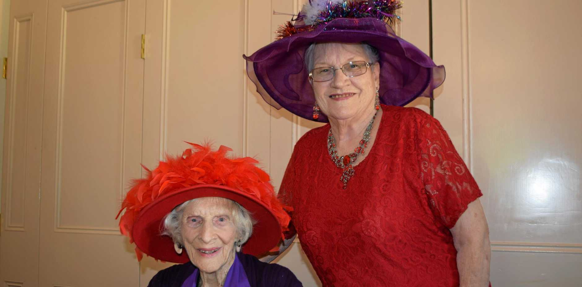 I SEE RED: The Red Hatters Queen Mother Florence Slattery with Nell Evans.