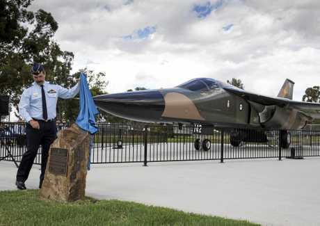 NEW HOME: The Chief of Air Force, Air Marshal Leo Davies, AO, CSC unveils a plaque commemorating the F-111 (A8-142) on display at the front gate at RAAF Base Wagga.