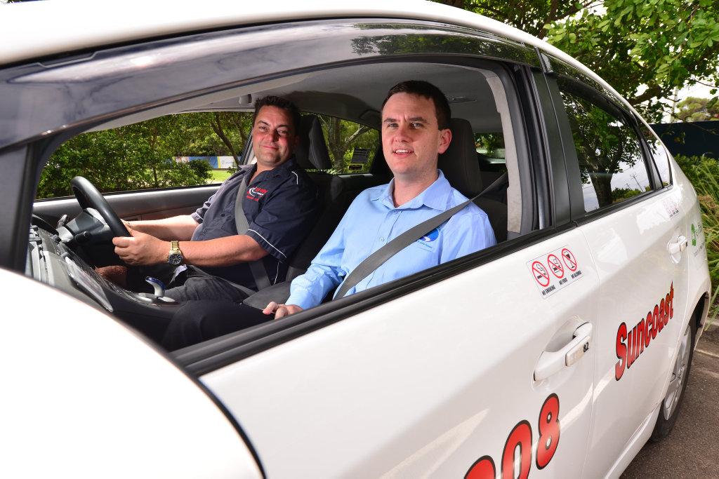 Suncoast Cabs operations manager Eli ten Dam (R).
