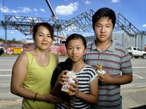 HOT COMPETITION: Hot Bread Bin owner Tuyet Huynh, with Johnny and Julie Nguyen, are concerned how the development on the old Bremer high school site will affect their business.