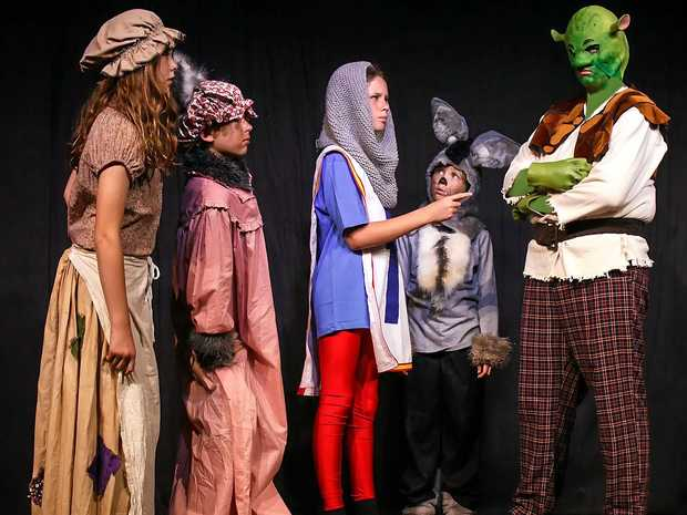 TALL TALE: Cinderella (Lauren Boyce), the Big Bad Wolf (Riley Venables), Donkey (Sophie Brazenor) and Shrek (River Fullager) are intercepted by the Captain of the Guards (Akira Harris) in Shrek Jr.