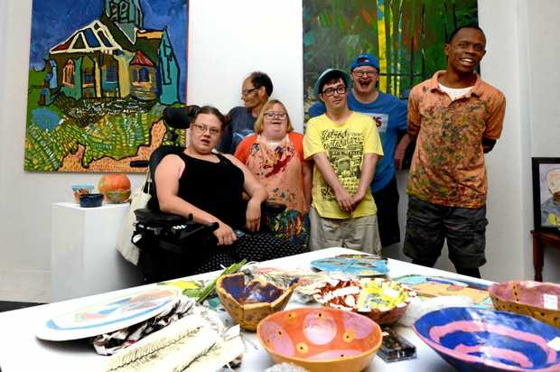 Some RED Inc artists with their artworks from a previous art exhibition in Lismore. From left, Naikia Taylor, John Rose, Amy Serone, Theo McPherson, Tim Thompson and Mbatha Nguta.