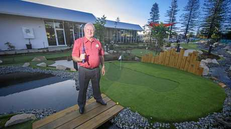 Yamba Bowling Club president Ian Lauder stands over 'Lake Lauder', the stream that runs through the middle of the new mini-golf course opened as part of the Family Leisure Centre at the Yamba Bowling Club.
