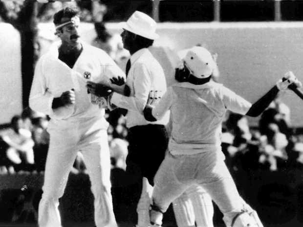 Cricket umpire Tony Crafter separates Australian fast bowler Dennis Lillee (left) and Pakistan batsman Javed Miandad in the first Test at Perth in 1981.